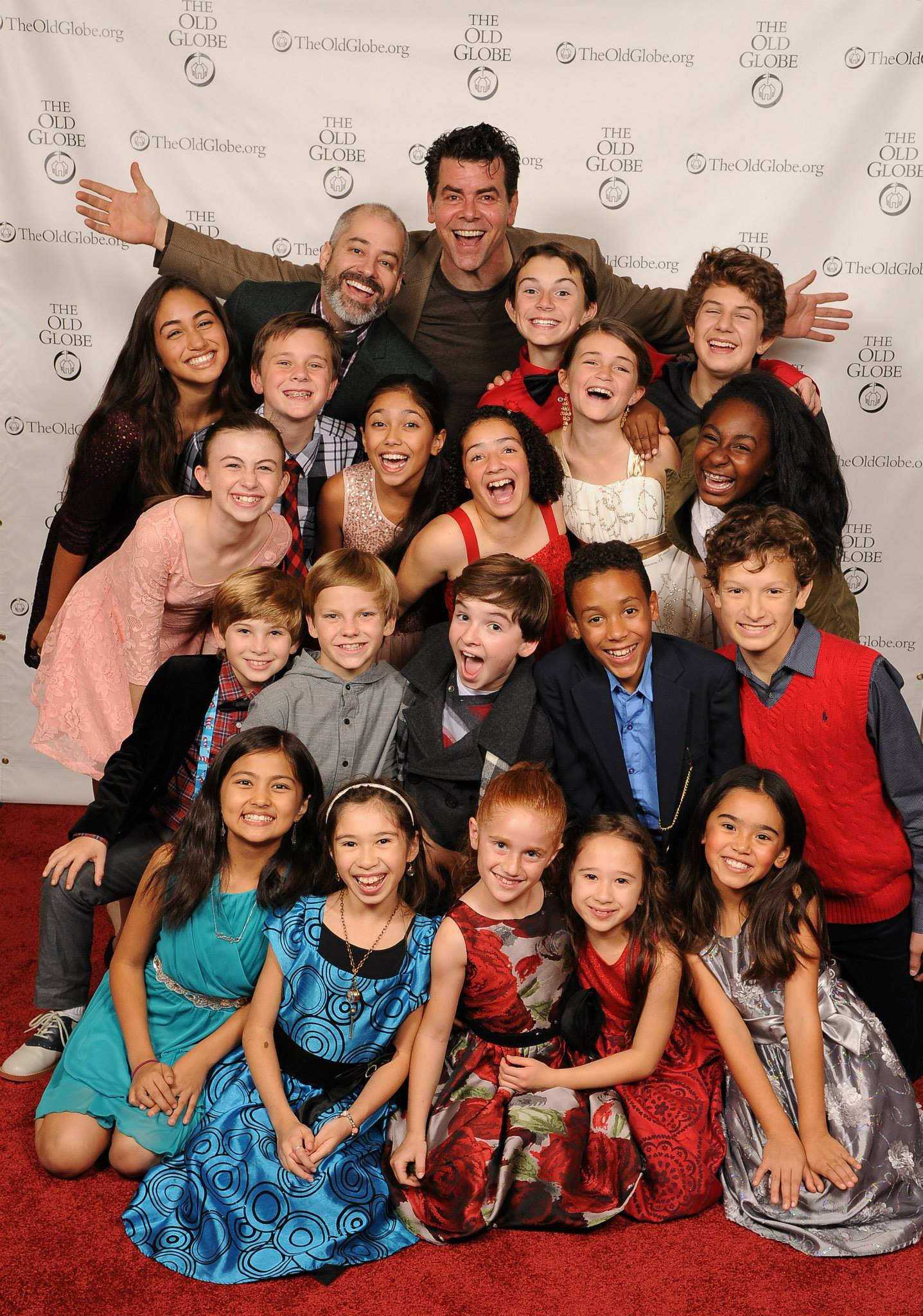 The kids of Whoville with Director James Vasquez and the Grinch (Burke Moses) - Photo by Douglas Gates.