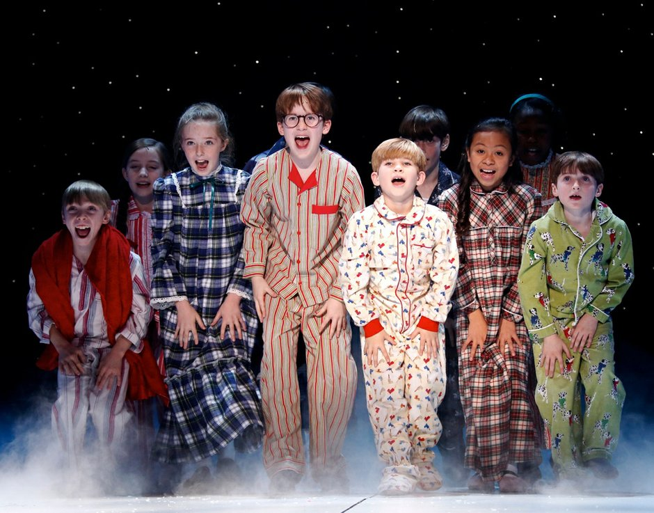 The kids of A Christmas Story: The Musical singing about Santa on his way to their houses. Photo Credit: Carol Rosegg