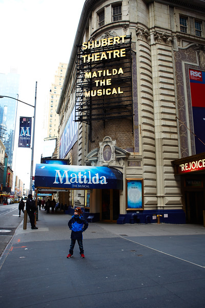 Noah in front of the Shubert Theatre